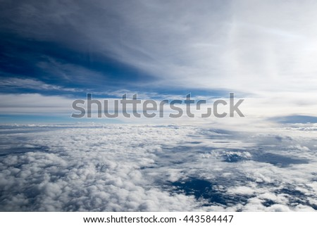 Skyline View above the Clouds from air plane. - stock photo