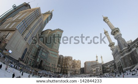 Skyline with  Abraj Al Bait (Royal Clock Tower Makkah) (left) in Makkah, Saudi Arabia. The tower is the tallest clock tower in the world at 601m (1972 feet), built at a cost of USD1.5 billion. - stock photo