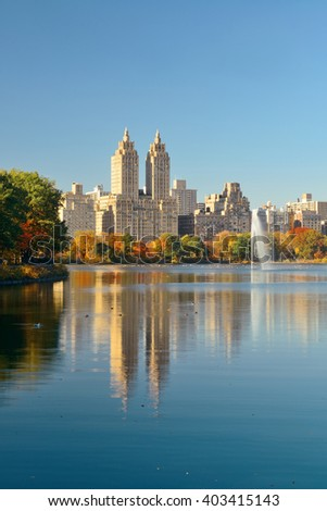 Skyline with apartment skyscrapers over lake with fountain in Central Park in midtown Manhattan in New York City - stock photo