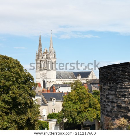 skyline with Saint Maurice Cathedral and wall of Angers Castle, France - stock photo