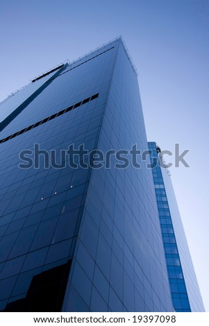 Skyscraper and blue sky, a view from the bottom - stock photo