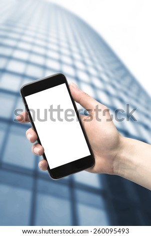 Skyscraper and the phone in his hand. Wide angle of view from below. - stock photo