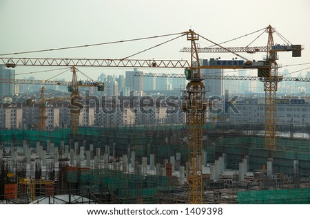Skyscraper construction with city skyline as background. More with keyword Series10. - stock photo