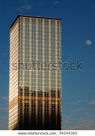 Skyscraper in Hong Kong and moon - stock photo