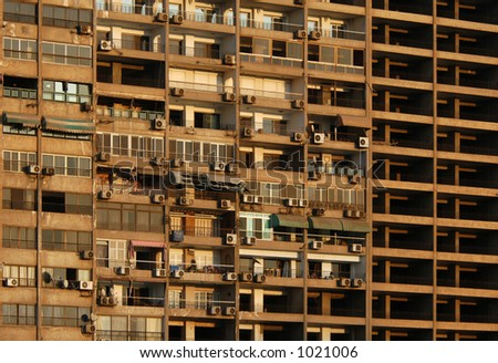 Skyscraper on the bank of the River Nile in Cairo, Egypt. - stock photo