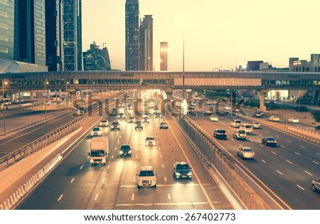 Skyscraper roads and bridge at the Sheikh Zayed Road in Dubai in the evening, United Arab Emirates - stock photo