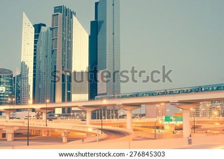 Skyscraper roads and bridge at the Sheikh Zayed Road in Dubai in the evening, United Arab Emirates - stock photo