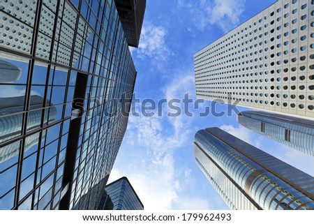 Skyscraper with clear blue sky - stock photo