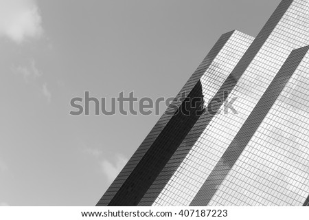 Skyscraper with glass facade. Modern building in Paris. Concepts of economics, financial, business  future. Copy space for text. Black and white. - stock photo