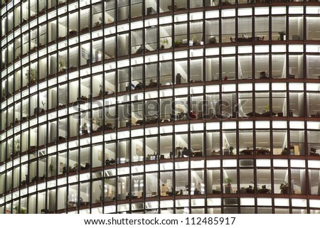 Skyscraper with offices and glass background - stock photo