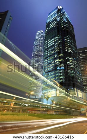 skyscraper with traffic light and cars motion blurred in Hong Kong.