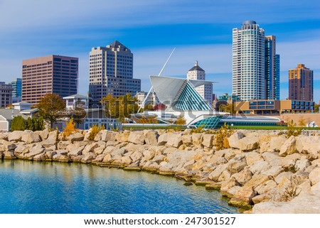 Skyscrapers  and skyline of Milwaukee and reflections in Lake Michigan, WI - stock photo
