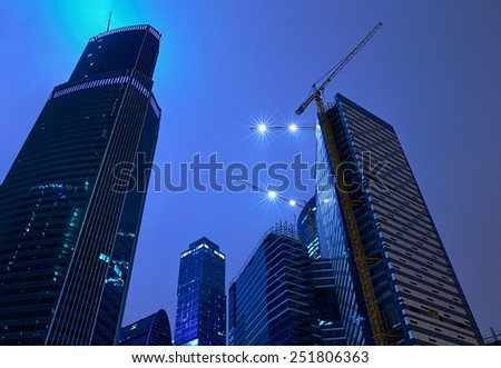 Skyscrapers and tower cranes at night in Moscow City, Russia - stock photo