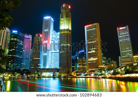 Skyscrapers at night Asia (Singapore, Downtown) - stock photo