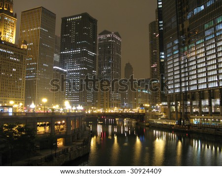 Skyscrapers in Downtown Chicago, Madison Avenue and Chicago River - stock photo