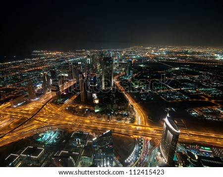 Skyscrapers in Dubai at night. View from the lookout Burj Khalifa. United Arab Emirates - stock photo