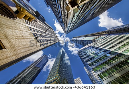 Skyscrapers in Midtown Manhattan, Madison Avenue and 56th Street, New York - stock photo