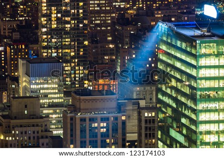 skyscrapers lights in New York at night - stock photo