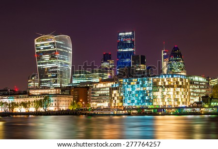 Skyscrapers of the City of London at night - England - stock photo