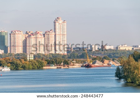 Skyscrapers on riverside with wharf and floating crane before. Moscow, Russia.  - stock photo