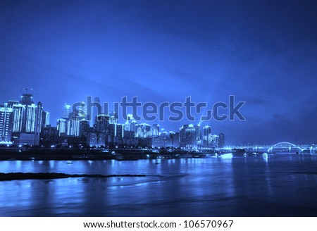 Skyscrapers reflecting in the river - stock photo