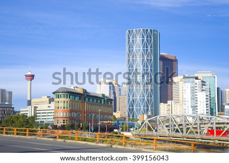 Skyscrapers towering over Calgary Alberta Canada with Bow river  - stock photo