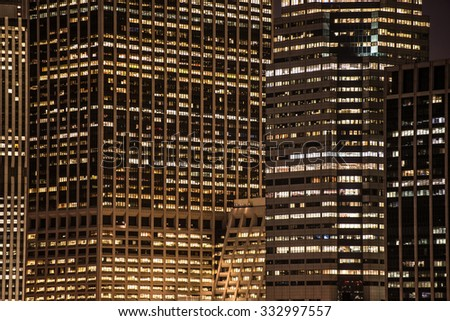 skyscrapers windows at the night in New York City  - stock photo