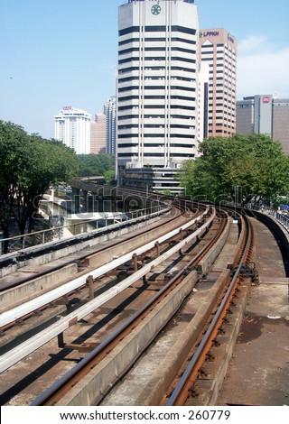Skytrain rails and highrise buildings  in Kuala Lumpur, Malaysia - stock photo