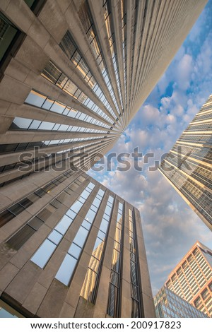 Skyward view of modern office buildings. - stock photo