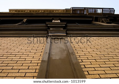 skyward view of the side of a rick building with unique architecture - stock photo