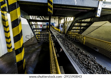 Slag on conveyor in thermal power station. - stock photo