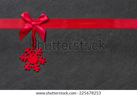Slate board with a felt snowflake - stock photo