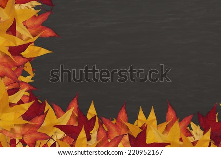 Slate chalkboard surrounded by colorful fall leaves - stock photo