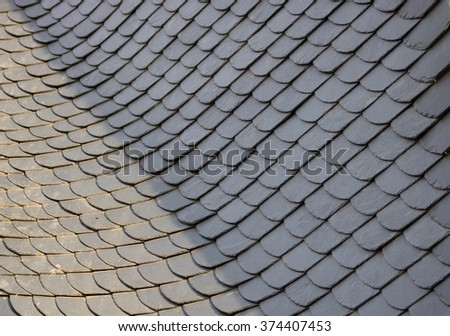 Slate-covered master roofing closeup - stock photo