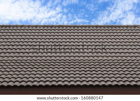 Slate roof against blue sky  - stock photo