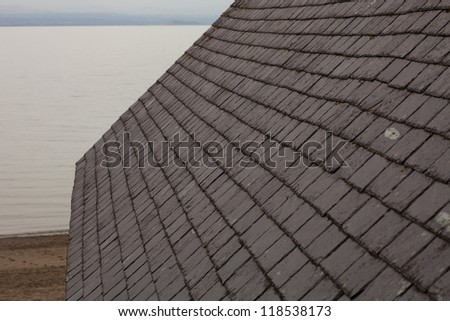 slate roof tiles on a building - stock photo