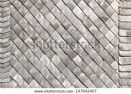 Slate shingles on house wall - stock photo