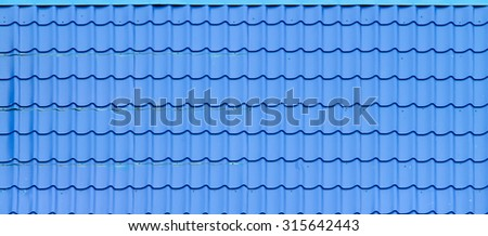 Slate tile roof of the house - stock photo
