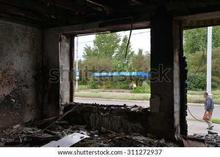SLAVJANSK, UKRAINE - JULY 15, 2014: the result of the shelling of a peaceful town militias. Mina got into the building and there was a fire. - stock photo