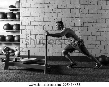 sled push man pushing weights workout exercise - stock photo