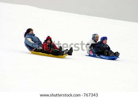 Sledging down hill - stock photo