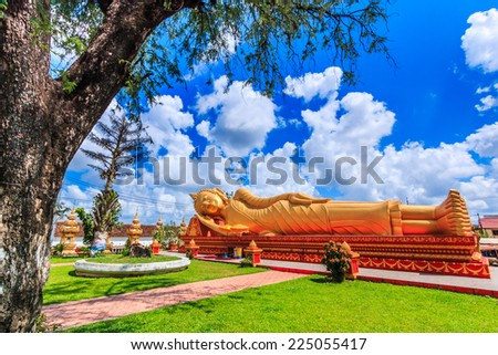 sleep  buddha in temple Vientiane, Laos , They are public domain or treasure of Buddhism, no restrict in copy or use  - stock photo