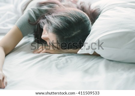 Sleep Girl on bed in the morning, model is a asian beauty - stock photo