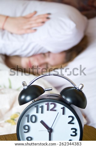 Sleep, wake up with alarm clock, get up is being frustrated. - stock photo