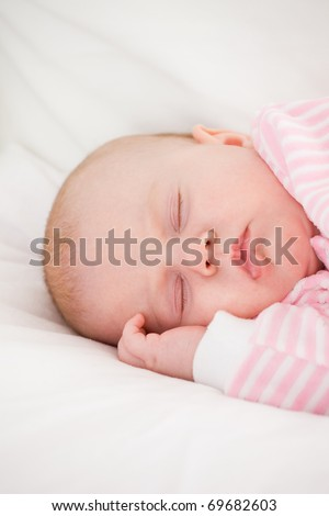 sleeping baby in striped toddlers close up - stock photo