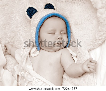 Sleeping Baby Wearing Knit Hat with Bear Ears - stock photo