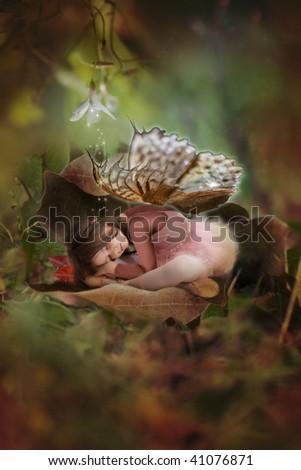 Sleeping beauty fairy in autun leaf - stock photo