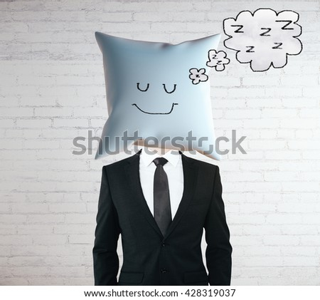 Sleeping businessman with smiley face on pillow instead of head - stock photo