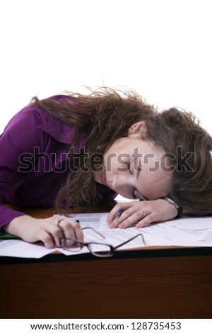 Sleeping businesswoman at an office desk isolated on white studio shot - stock photo