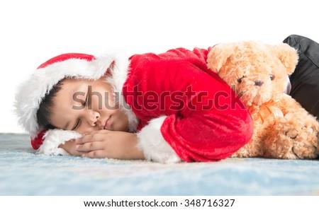 Sleeping fat boy waiting for Santa isolated on white background - stock photo